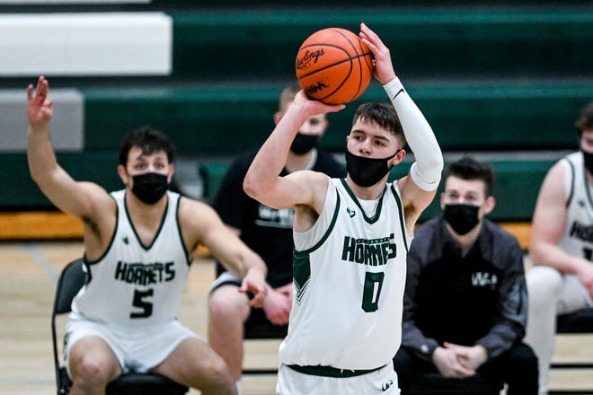 Williamston's Jacob Wallace makes a 3-pointer against Fowlerville during the third quarter on Tuesday, Feb. 16, 2021, at Williamston High School.