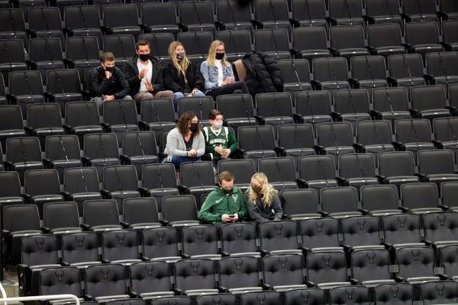 Fans watch the Bucks play the Toronto Raptors earlier this season at Fiserv Forum.