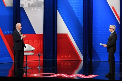 President Joe Biden talks with CNN anchor Anderson Cooper as he participates in a CNN town hall at the Pabst Theater in Milwaukee, Wisconsin, Feb. 16, 2021.