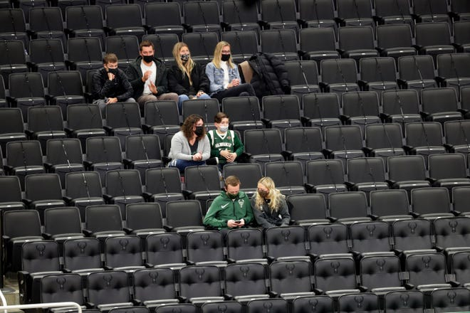 Fans watch the Milwaukee Bucks play the Toronto Raptors during the first half of their game Tuesday at Fiserv Forum. This was the first Bucks home game open to the public as about 250 fans were allowed to attend the game.    MARK HOFFMAN/MILWAUKEE JOURNAL SENTINEL