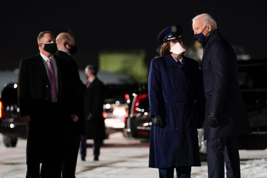 President Joe Biden talks with Col. Adria Zuccaro, commander of the 128th Air Refueling Wing, as he arrives at Milwaukee Mitchell International Airport to participate in a town hall event at Pabst Theater, Tuesday, Feb. 16, 2021, in Milwaukee.