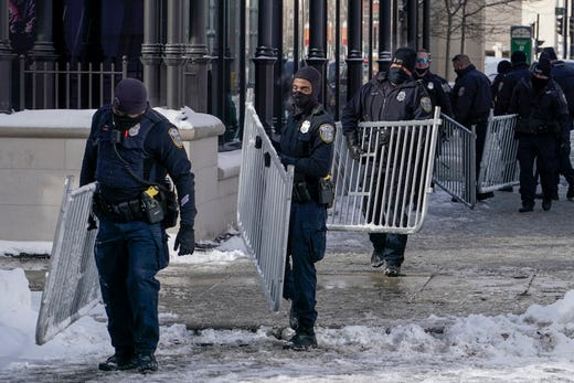 Police are seen outside The Pabst Theater Tuesday, Feb. 16, 2021, in Milwaukee. President Joe Biden is scheduled to attend a town hall meeting on Tuesday night.