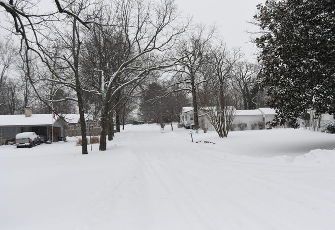 Mountain Home residents woke up Wednesday morning to find an additional 2.5 inches of snow on the ground.