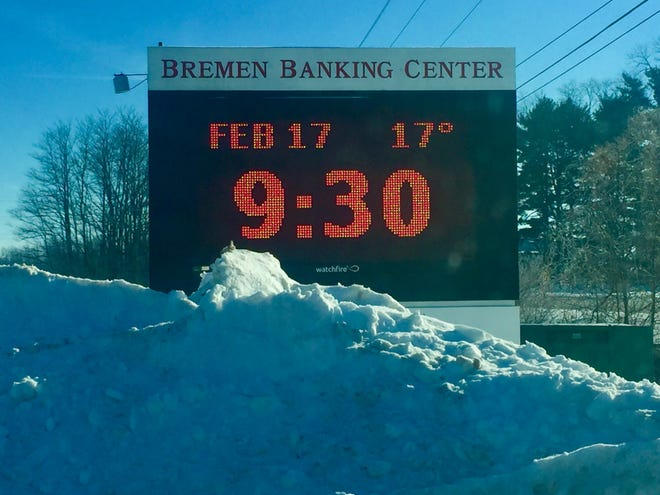 This sign in front of Pataskala's Bremen Banking Center says it all on an icy Wednesday morning: Mounds of snow and below-freezing temperatures that have caused water lines to burst.