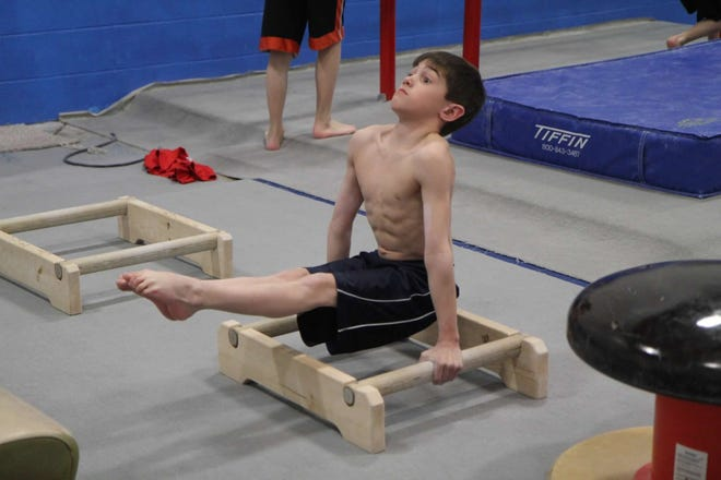 Michael Jaroh started gymnastics with his twin sister Jessica at age 6.
