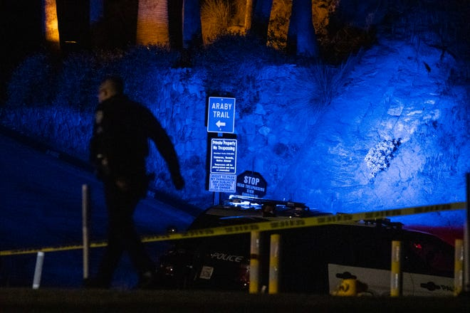 Police investigate a suspicious device near the Araby Trail in Palm Springs, Calif., February 16, 2021.
