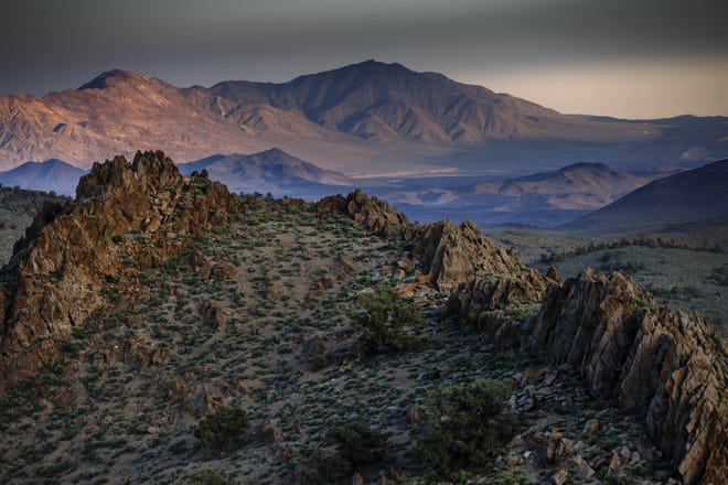View of Conglomerate Mesa's spiny conglomerate shale peaks, with the Argus Range and Death Valley National Park in the background.