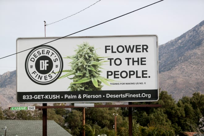 A billboard for Desert's Finest cannabis dispensary advertises to drivers going eastbound on Interstate-10 near Cabazon, Calif. on Tuesday, February 16, 2021.