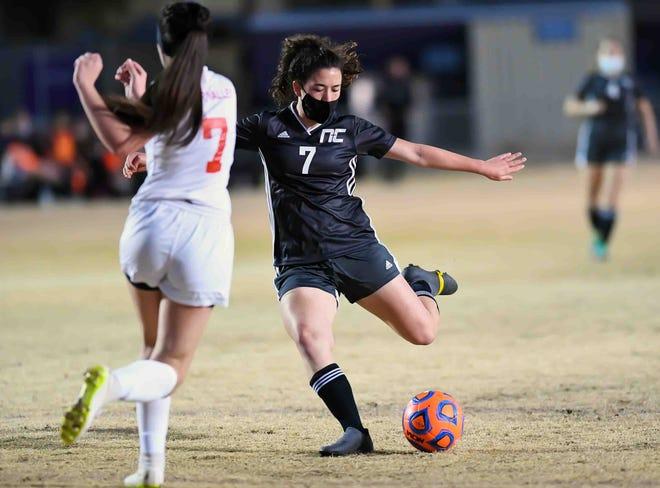 Northwest Christian girls soccer forward Ellie Johannes (black jersey, No. 7) kicks the ball during a match