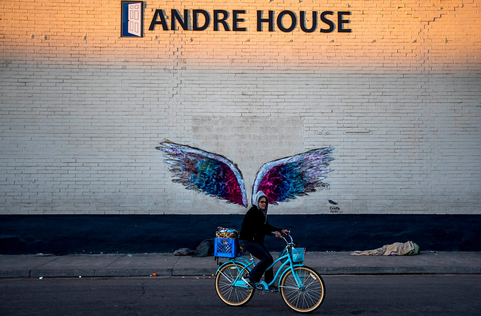 Darlene Carchedi, known as Mama D, bikes to the Andre House in Phoenix for dinner on Feb. 26, 2020.