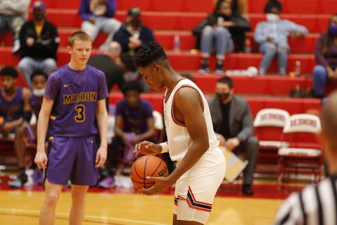 Richmond boys basketball junior forward Stephen Douglas shooting a free throw against Marion in the Tiernan Center on Dec. 11, 2020.