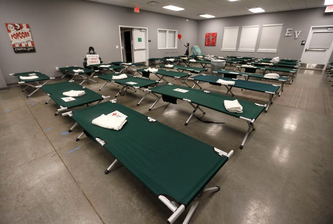 Cots set up at Eden Village on Tuesday, Feb. 16, 2021 for an emergency cold weather shelter.