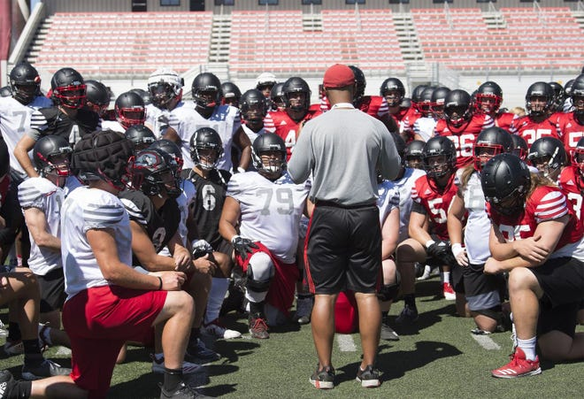 The SUU football team gathers during a practice.