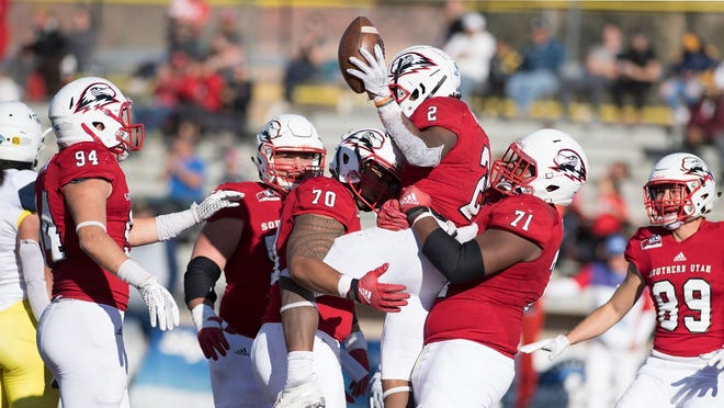 Southern Utah running back Thomas Duckett (2) celebrates with the offense after scoring against Northern Arizona.