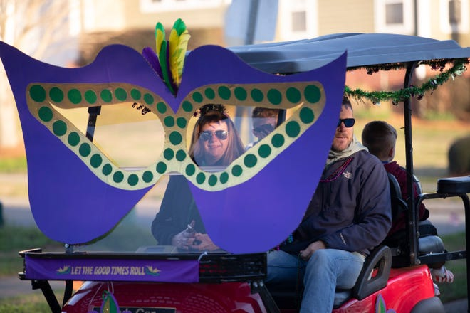 A small group of golf cart owners in Southwood paraded through the neighborhood as they celebrated Mardi Gras with a short, socially distanced parade Tuesday, Feb. 16, 2021.