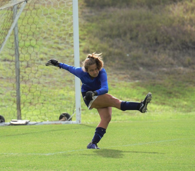 The Pine School goalkeeper Keziah Anderson sends down a goal kick against Cambridge Christian during a 3-2A regional quarterfinal match on Tuesday, Feb. 17, 2021. The Lancers eliminated the Knights with an 8-1 victory.