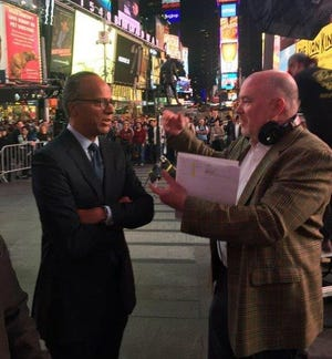 Lester Holt and Paul Ryan at Times Square in 2015