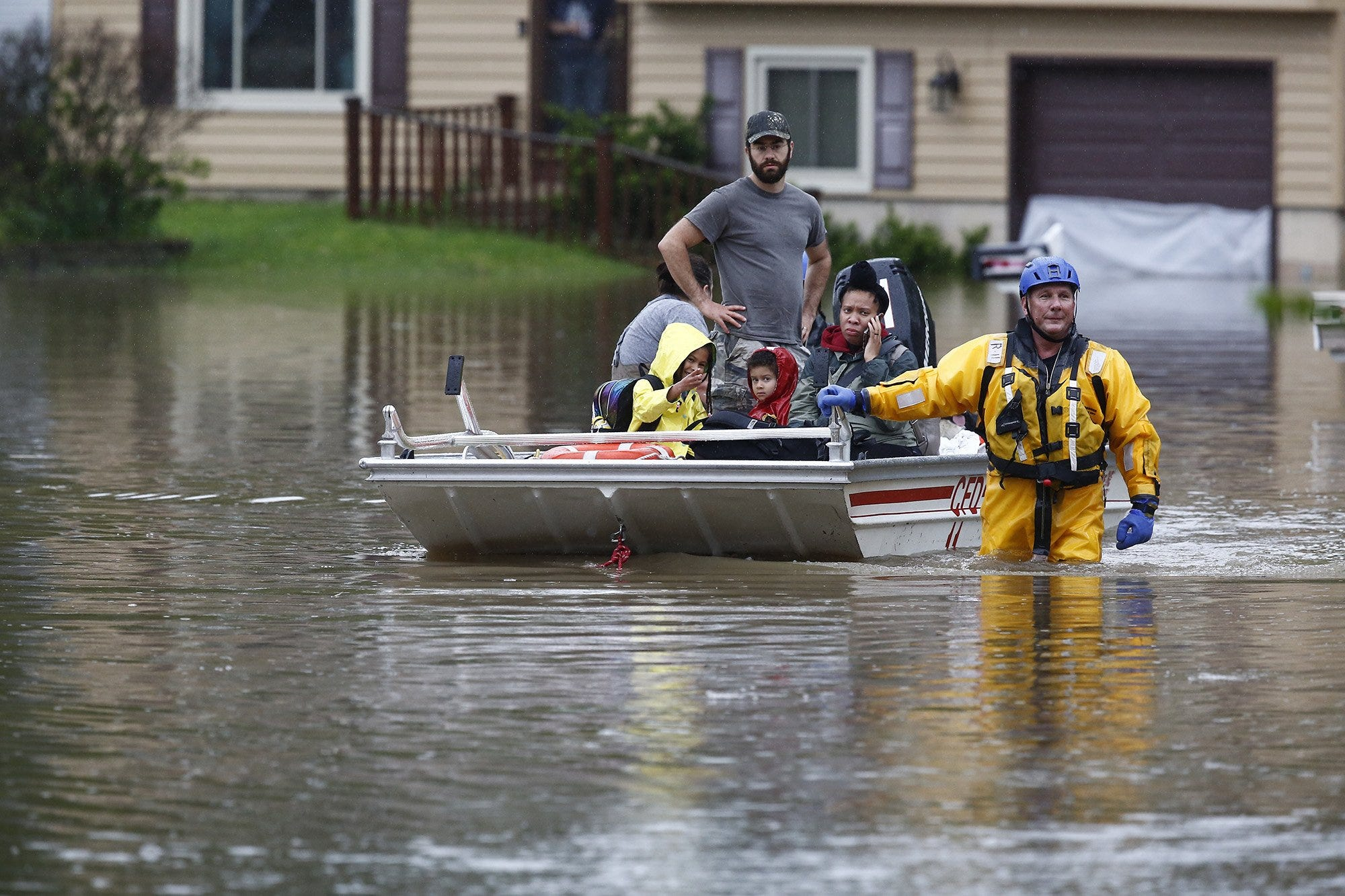 The Columbus Fire Department uses a boat to evacuate people from their homes on Stoneshead Ct. on Tuesday, May 19, 2020 after heavy rains pounded the area overnight.