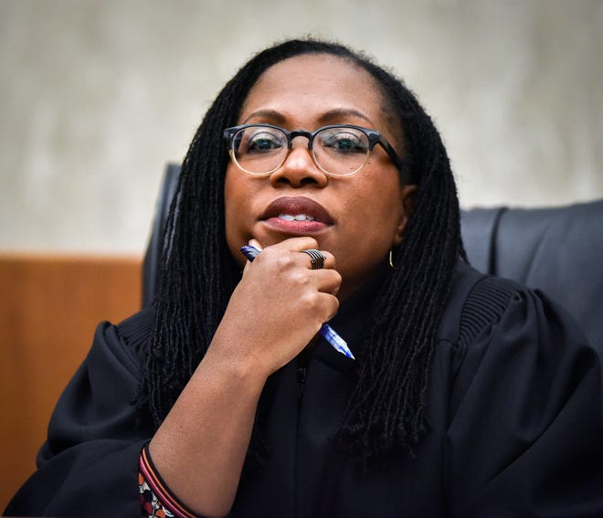 Judge Ketanji Brown Jackson listens to arguments as local high school students observe a reenactment of a landmark Supreme court case at U.S. Court of Appeals in Washington, DC.