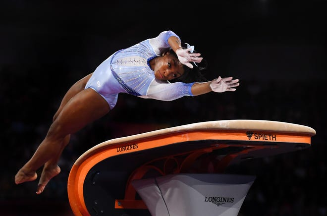 Simone Biles competing on the vault at the world championships in Germany in 2019.
