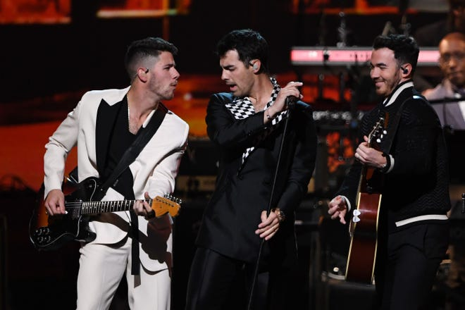 Nick Jonas, Joe Jonas and Kevin Jonas of the Jonas Brothers perform onstage during the 2020 MusiCares Person Of The Year gala honoring US rock band Aerosmith at the Los Angeles Convention Center in Los Angeles on January 24, 2020.