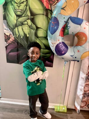 Moses Johnson, a kindergartner, poses for a photo on his 6th birthday. His mother, Denise Ladson Johnson, has been homeschooling him during the COVID-19 pandemic.