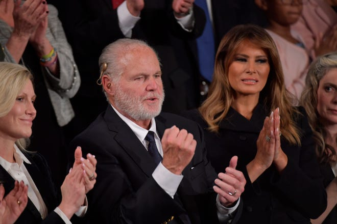 Rush Limbaugh sits next to First Lady Melania Trump in the First Lady's box as  President Donald J. Trump delivers the State of the Union address from the House chamber of the United States Capitol in Washington on Feb. 4, 2020. The conservative radio talk show host died Wednesday, Feb. 17, 2021 of lung cancer.