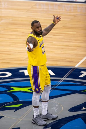 Los Angeles Lakers forward LeBron James reacts after a foul is called in the second half against the Minnesota Timberwolves at Target Center.