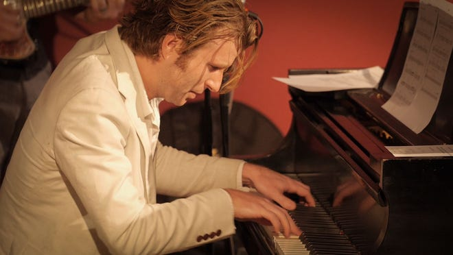 Austin musician Dave Madden got trapped in a hotel during the winter storm but ended up with a  new piano gig.