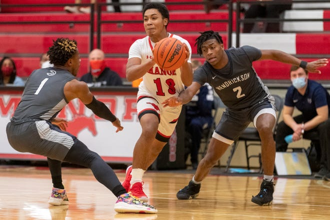 Manor guard Augustine Arroyo, driving to the basket against Hendrickson earlier this season, scored 33 points in the regular-season finale against Pflugerville. The Mustangs will enter the playoffs as the No. 3 seed in District 18-5A.