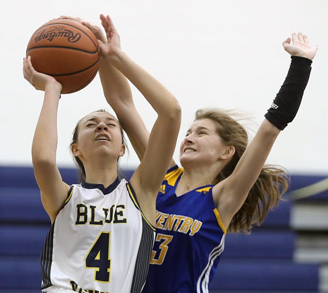 Tallmadge's Gia Currey, left, makes a layup against Coventry's Hannah Ragland during the second half of a Division II sectional basketball game, Wednesday, Feb. 17, 2021, in Tallmadge, Ohio. [Jeff Lange/Beacon Journal]