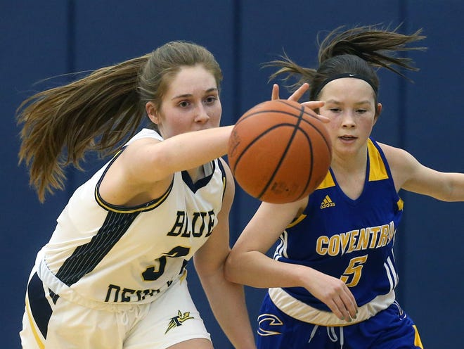 Tallmadge's Maya Dexter, left, reaches for a loose ball against Coventry's Gabby Dick during the first half of a Division II sectional basketball game, Wednesday, Feb. 17, 2021, in Tallmadge, Ohio. [Jeff Lange/Beacon Journal]