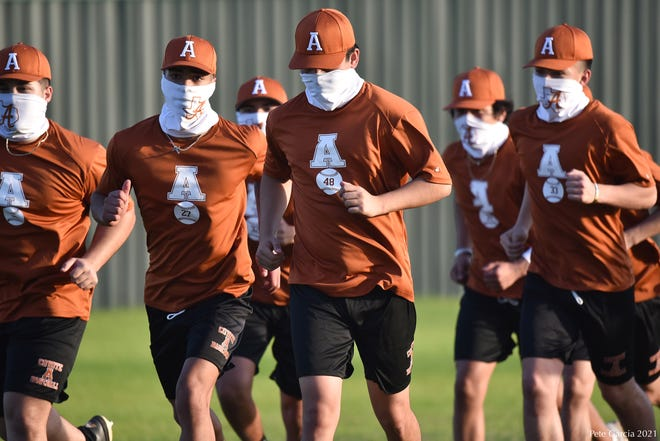 Alice baseball players go through warmups before practice in Alice.