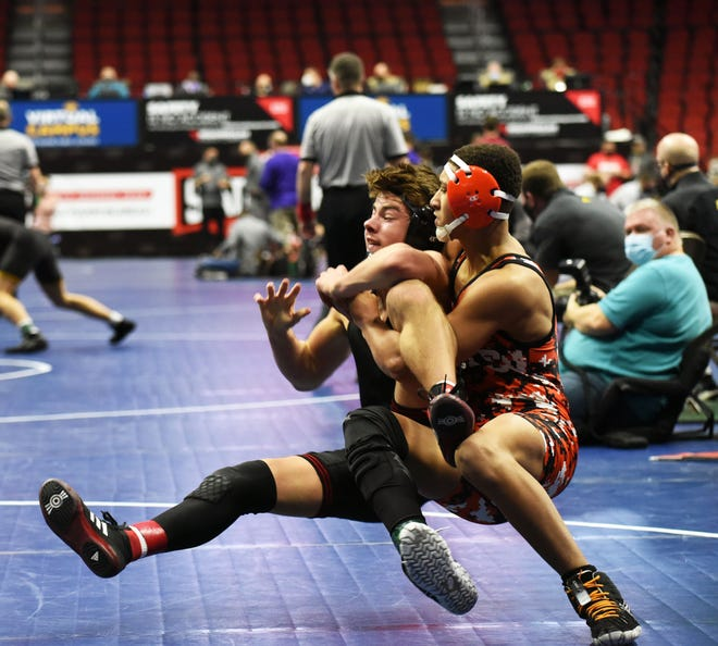 Ames freshman Brent Slade gets Mason City's Wiemann in a cradle during in their third period of their match during the Class 3A first round of the state wrestling tournament Thursday in Des Moines. Slade got two back points with the move in scoring a 6-1 victory at 145 pounds.