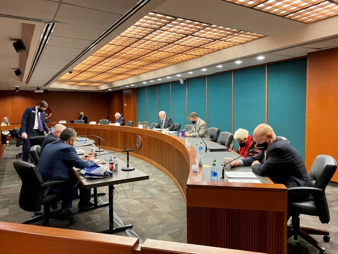 Georgia lawmakers on the state Senate Ethics Committee pray before considering election-focused bills on Feb. 18.