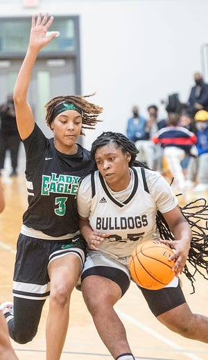 Butler's Brionna Sims, right, is pressured by Josey defender Arionna Booker during Regional Championship game at Butler High School in Augusta, Ga., Wednesday evening February 17, 2021.