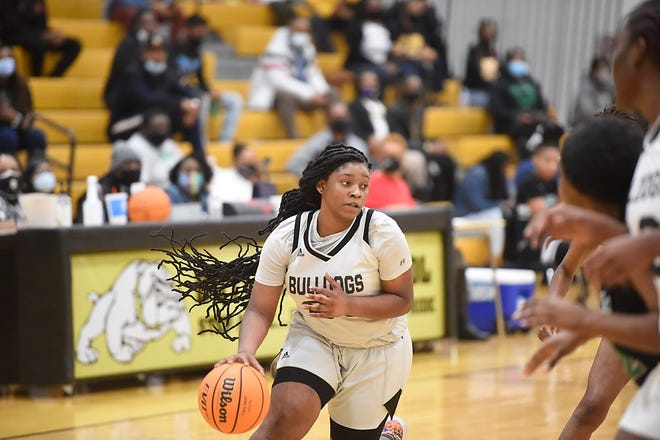 Butler, in white, takes on Josey during the Regional Championship game at Butler High School in Augusta, Ga., Wednesday evening February 17, 2021.