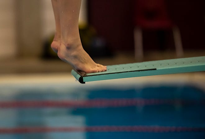 Central Valley High School diver Payton Sarver  goes to the edge of the board during practice at the Beaver High School pool.