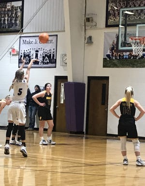 Booneville sophomore Leigh Swint (5) shoots a free throw against Hackett in a district tournament game at Booneville on Feb. 13.  Swint hit 12 of 16 from the stripe in the Ladycats' 48-39 win. The Ladycats finished with a 13-9 record for the season after the remainder of the district tournament was canceled.