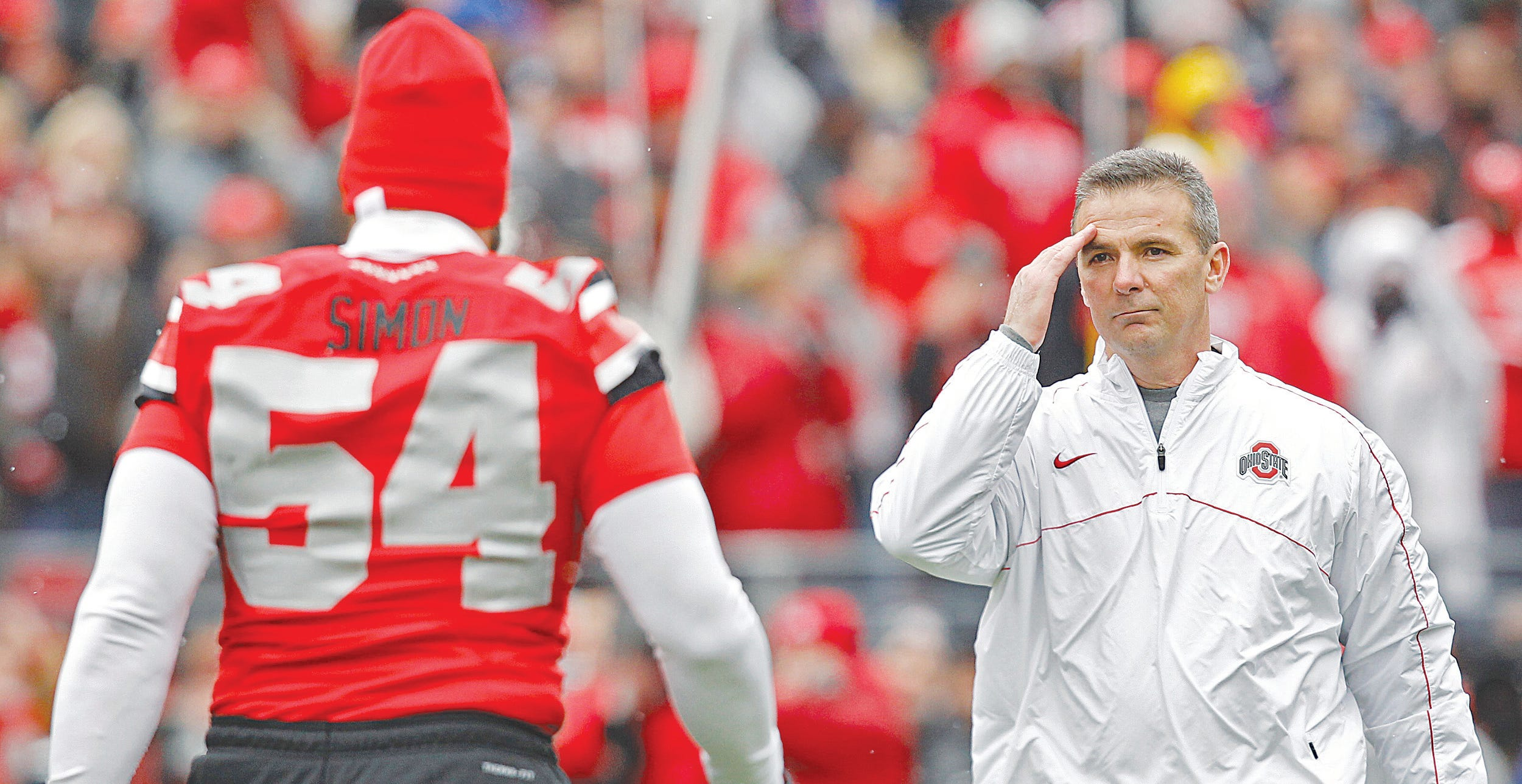 Urban Meyer honors defensive lineman John Simon on Senior Day at Ohio Stadium. A knee injury kept Simon — the heart and soul of the 2012 team — out of the Michigan game.
