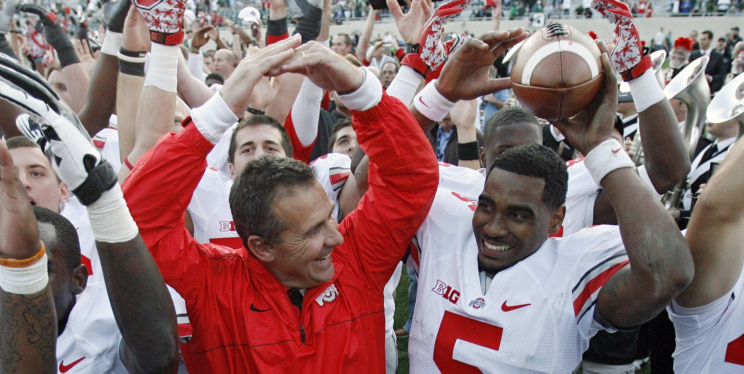 Urban Meyer came to love star quarterback Braxton Miller (5) and the rest of the 2012 Buckeyes, and to this day does not understand why they were punished for NCAA violations committed by predecessors.