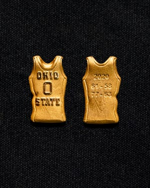 "The ""gold jersey"" trinkets that members of the 2019-20 Ohio State men's basketball team earned for sweeping their season series against Michigan."