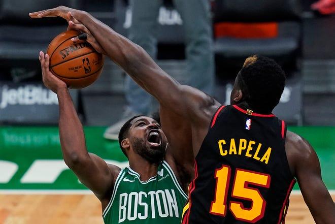 Atlanta Hawks center Clint Capela (15) blocks a shot by Boston Celtics forward Tristan Thompson, left, during the Wednesday's game in Boston.