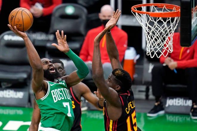 Boston Celtics guard Jaylen Brown (7) shoots over Atlanta Hawks center Clint Capela (15) during Wednesday's game in Boston.