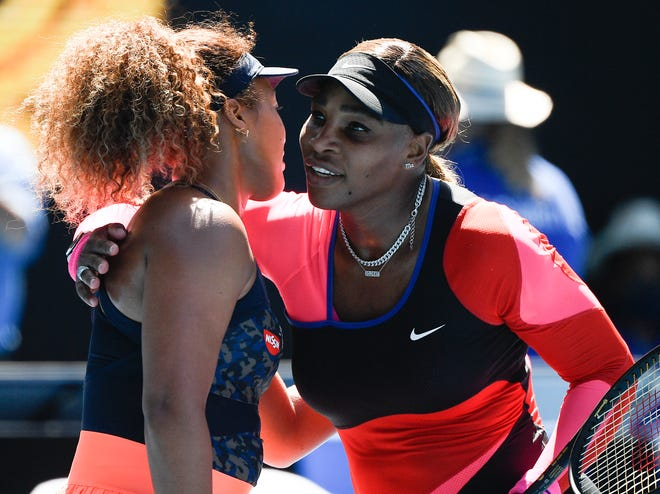 Japan's Naomi Osaka, left, is congratulated by United States' Serena Williams after winning their semifinal match at the Australian Open on Thursday in Melbourne, Australia.
