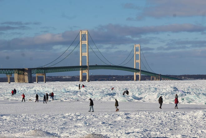 Large groups of people have started to come to Mackinaw City in the middle of winter, just to see the ice piling up on the shores of Lake Michigan and Lake Huron, which at times look to be blue.