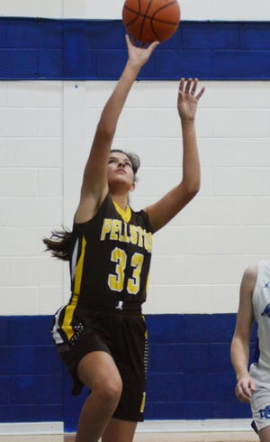 Vivian Dyer (33) finished with eight points and eight rebounds for the Pellston varsity girls basketball team in a home loss to Gaylord St. Mary on Wednesday.