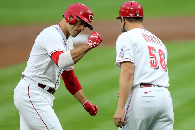 Veteran first baseman Joey Votto (19) will be a key player if the Cincinnati Reds are to improve their miserable offense in 2020, when they had a major-league worst .212 batting average.