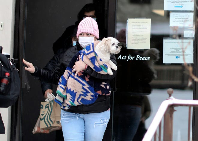 On Feb. 18, Edith Espinal held her dog, Bella, while leaving the Columbus Mennonite Church for the first time in three years. On Wednesday, she was told that a large fine levied against her by immigration officials was being dropped.