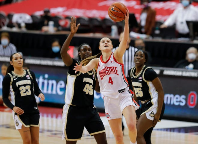 Ohio State Buckeyes guard Jacy Sheldon (4) drives to the basket ahead of Purdue Boilermakers center Fatou Diagne (45) and guard Tamara Farquhar (25) during the first quarter of the NCAA women's college basketball game at Value City Arena in Columbus on Thursday, Feb. 18, 2021.